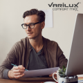 Man sat at computer wearing Essilor Varilux Comfort Max Lenses